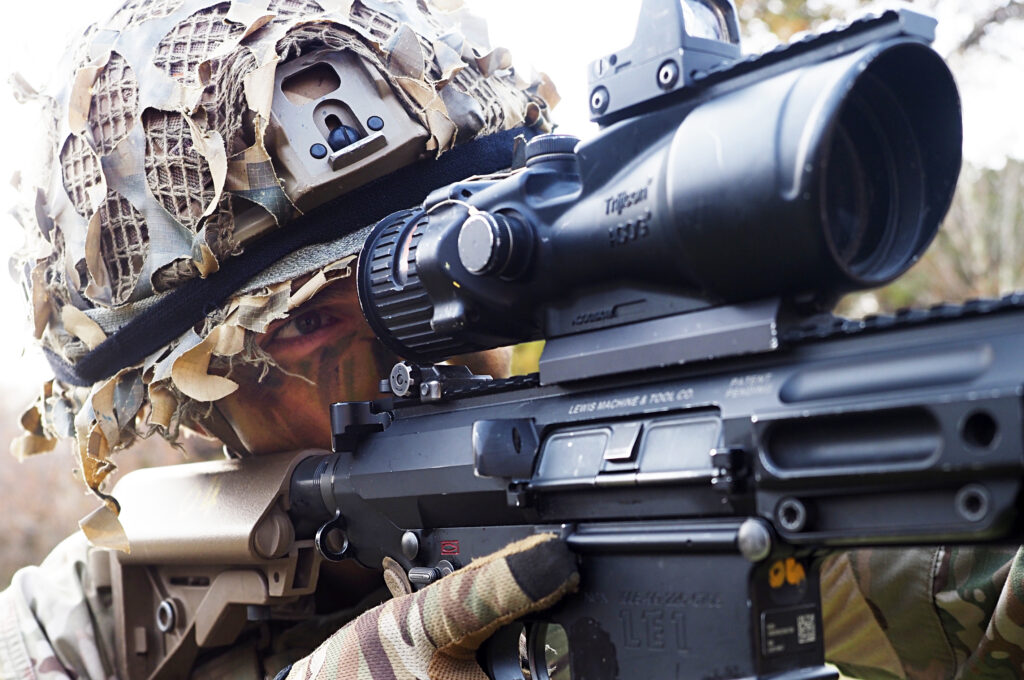 Donate Support The Army Leader Fundraising A soldier looks down the scope of a sharpshooter rifle